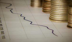 Münzen auf Chart: Marketingerfolg messbar machen