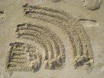 RSS Logo im Sand gezeichnet